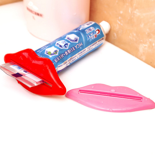 זוג סוחטי שפופרות שיניים בצורת